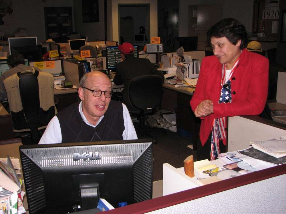 City Editor Rob Brill and News & Information Desk Coordinator/Office Mom Azra Haqqie. Azra said tonight's Dinosaur Bar-B-Que ranks second to the Moe's feast four years ago, back when they built the restaurant across the street. I give the nod to Dinosaur, only because I'm sick of Moe's faux Mexi-smell when the wind blows north.