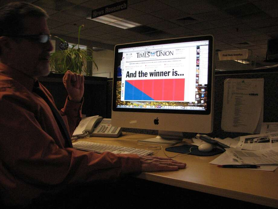 News Editor Gary Hahn works on the layout of tomorrow's A1. No photo yet.