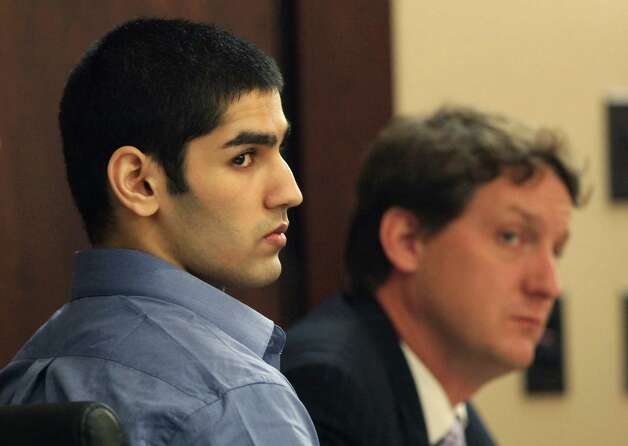 Jasjeet Singh, left, and one of his lawyers Donald Flanary III, listen to questioning in the 290th District Court, during Singh's trial for shooting friend and fellow classmate Brian Odipo, two years ago.  Thursday, Nov. 1, 2012. Photo: Bob Owen, San Antonio Express-News / © 2012 San Antonio Express-News