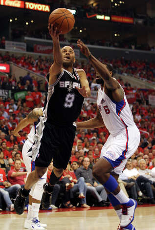 San Antonio Spurs' Tony Parker (09) drives past Los Angeles Clippers' DeAndre Jordan (06) in the first quarter during game four of the Western Conference semifinals at Staples Center in Los Angeles, Sunday, May 20, 2012.  Jerry Lara/San Antonio Express-News Photo: Jerry Lara, San Antonio Express-News / © San Antonio Express-News