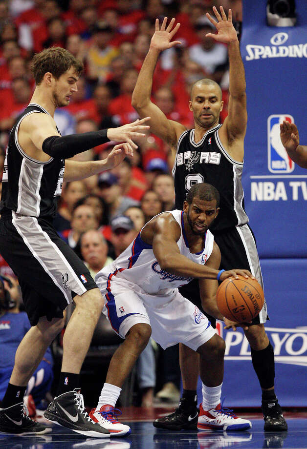 San Antonio Spurs' Tiago Splitter (22) and Tony Parker (09) pressure Los Angeles Clippers' Chris Paul (03) in the first quarter during game four of the Western Conference semifinals at Staples Center in Los Angeles, Sunday, May 20, 2012.  Jerry Lara/San Antonio Express-News Photo: Jerry Lara, San Antonio Express-News / © San Antonio Express-News
