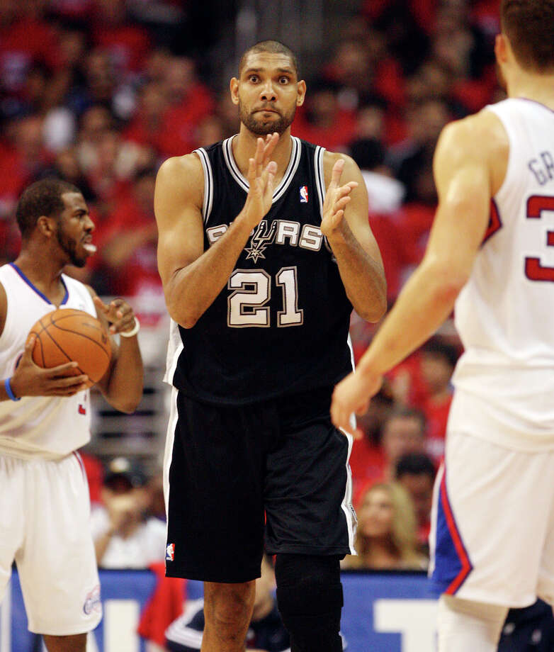 San Antonio Spurs' Tim Duncan (21) applauds after the Los Angeles Clippers turned over the ball in the first quarter during game four of the Western Conference semifinals at Staples Center in Los Angeles, Sunday, May 20, 2012.  Jerry Lara/San Antonio Express-News Photo: Jerry Lara, San Antonio Express-News / © San Antonio Express-News