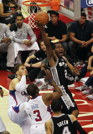 Spurs' Kawhi Leonard (02) goes for a reverse layup against the Los Angeles Clippers' Blake Griffin (32) and Chris Paul (03) in the first half of game four of the Western Conference semifinals at the Staples Center in Los Angeles on Sunday, May 20, 2012. Kin Man Hui/Express-News Photo: Kin Man Hui, SAN ANTONIO EXPRESS-NEWS / San Antonio Express-News