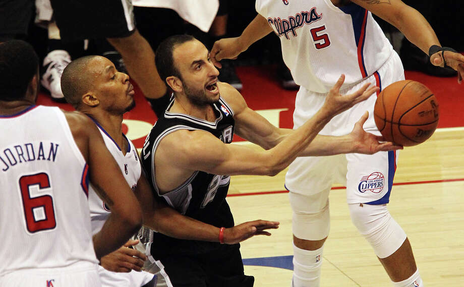 Spurs' Manu Ginobili (20) drives the basket against the Los Angeles Clippers in the first half of game four of the Western Conference semifinals at the Staples Center in Los Angeles on Sunday, May 20, 2012. Kin Man Hui/Express-News Photo: Kin Man Hui, SAN ANTONIO EXPRESS-NEWS / San Antonio Express-News