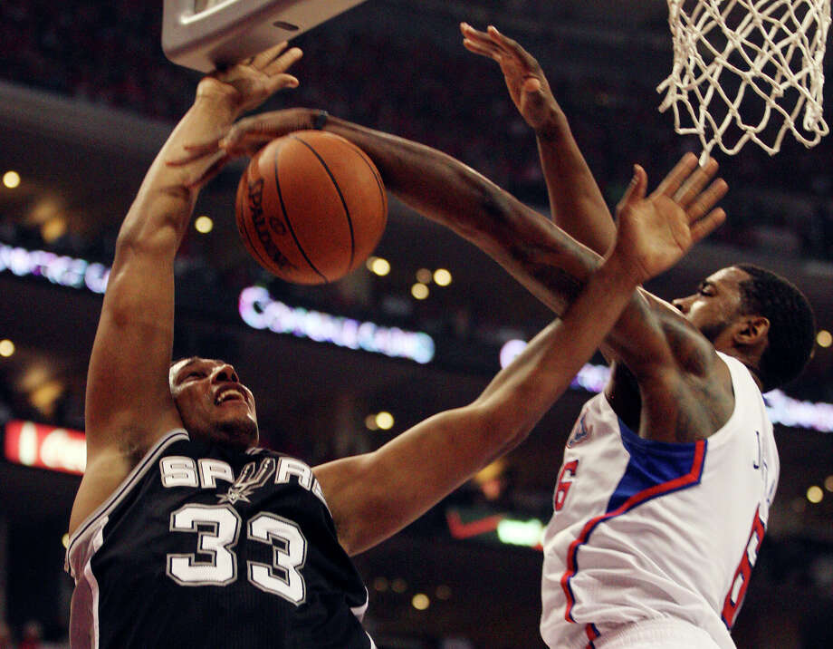 San Antonio Spurs' Boris Diaw (33) gets blocked by Los Angeles Clippers' DeAndre Jordan (06) in the first quarter during game four of the Western Conference semifinals at Staples Center in Los Angeles, Sunday, May 20, 2012.  Jerry Lara/San Antonio Express-News Photo: Jerry Lara, San Antonio Express-News / © San Antonio Express-News