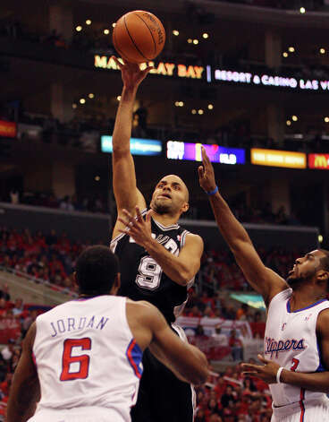 San Antonio Spurs' Tony Parker (09) shoots against Los Angeles Clippers' Chris Paul (03) and DeAndre Jordan (06) in the first quarter during game four of the Western Conference semifinals at Staples Center in Los Angeles, Sunday, May 20, 2012.  Jerry Lara/San Antonio Express-News Photo: Jerry Lara, San Antonio Express-News / © San Antonio Express-News