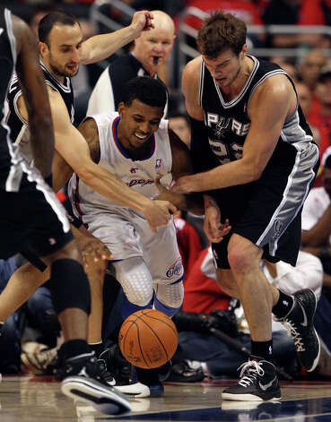 San Antonio Spurs Stephen Jackson (03), Manu Ginobili (20) and Tiago Splitter (22), surround Los Angeles Clippers Nick Young (11), during game four of the Western Conference semifinals at Staples Center in Los Angeles, Sunday, May 20, 2012.  Jerry Lara/San Antonio Express-News Photo: Jerry Lara, San Antonio Express-News / © San Antonio Express-News