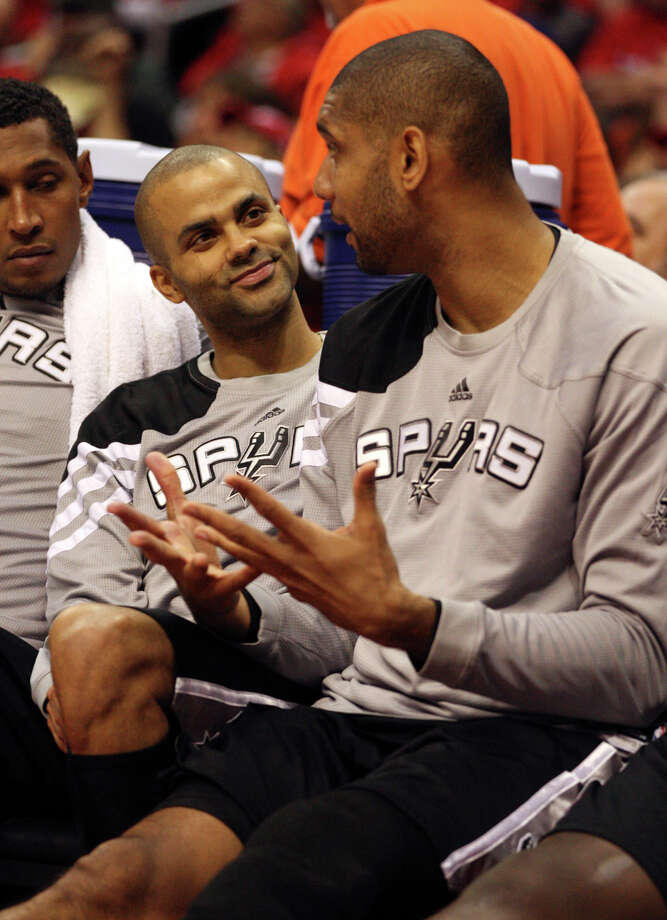 San Antonio Spurs Tony Parker (09) and Tim Duncan (21) talks on the bench during a break against the Los Angeles Clippers during game four of the Western Conference semifinals at Staples Center in Los Angeles, Sunday, May 20, 2012.  Jerry Lara/San Antonio Express-News Photo: Jerry Lara, San Antonio Express-News / © San Antonio Express-News