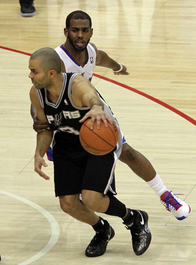 Spurs' Tony Parker (09) gets grabbed by the Los Angeles Clippers' Chris Paul (03) in the second half of game four of the Western Conference semifinals at the Staples Center in Los Angeles on Sunday, May 20, 2012. Kin Man Hui/Express-News Photo: Kin Man Hui, SAN ANTONIO EXPRESS-NEWS / San Antonio Express-News