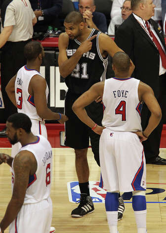 Spurs' Tim Duncan (21) debates a call with Los Angeles Clippers' Chris Paul (03) and Randy Foye (04) in the second half of game four of the Western Conference semifinals at the Staples Center in Los Angeles on Sunday, May 20, 2012. Kin Man Hui/Express-News Photo: Kin Man Hui, SAN ANTONIO EXPRESS-NEWS / San Antonio Express-News