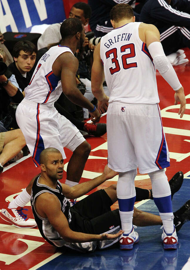 Spurs' Tony Parker (09) looks for a call but doesn't get one against Los Angeles Clippers' Chris Paul (03) and Blake Griffin (32) in the second half of game four of the Western Conference semifinals at the Staples Center in Los Angeles on Sunday, May 20, 2012. Kin Man Hui/Express-News Photo: Kin Man Hui, SAN ANTONIO EXPRESS-NEWS / San Antonio Express-News