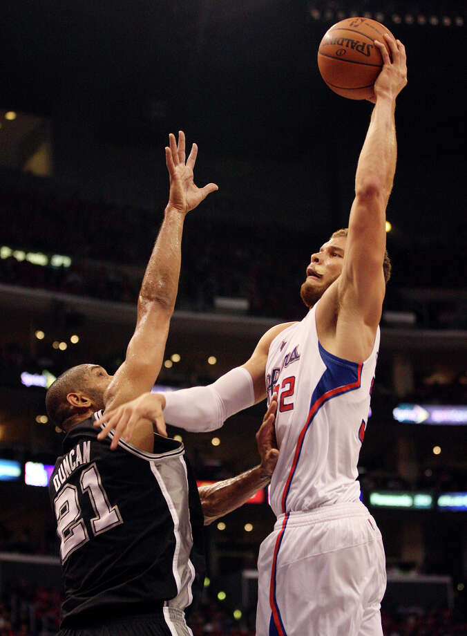 San Antonio Spurs' Tim Duncan (21) attempts to defend against Los Angeles Clippers' Blake Griffin (32) in the third quarter of game four of the Western Conference semifinals at Staples Center in Los Angeles, Sunday, May 20, 2012.  Jerry Lara/San Antonio Express-News Photo: Jerry Lara, San Antonio Express-News / © San Antonio Express-News