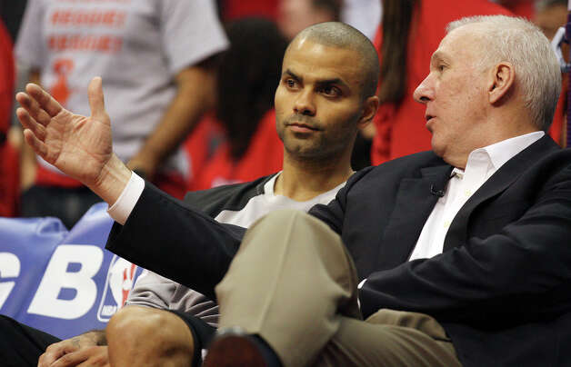 San Antonio Spurs' Tony Parker (09) talks with head coach Gregg Popovich during their game against the Los Angeles Clippers in the third quarter of game four of the Western Conference semifinals at Staples Center in Los Angeles, Sunday, May 20, 2012.  Jerry Lara/San Antonio Express-News Photo: Jerry Lara, San Antonio Express-News / © San Antonio Express-News