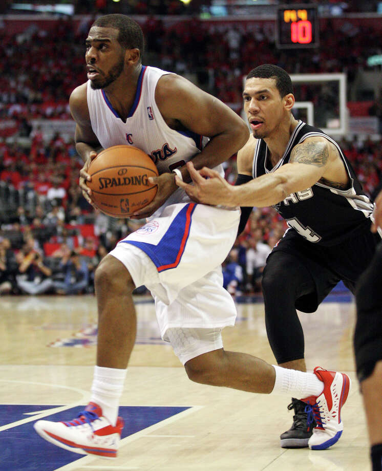 San Antonio Spurs' Danny Green (04) attempts to steal the ball from Los Angeles Clippers' Chris Paul (03) in the third quarter of game four of the Western Conference semifinals at Staples Center in Los Angeles, Sunday, May 20, 2012.  Jerry Lara/San Antonio Express-News Photo: Jerry Lara, San Antonio Express-News / © San Antonio Express-News
