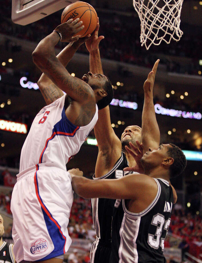 San Antonio Spurs' Tim Duncan (21) and Boris Diaw (33) attempt to block a shot by Los Angeles Clippers' DeAndre Jordan (06) in the third quarter of game four of the Western Conference semifinals at Staples Center in Los Angeles, Sunday, May 20, 2012.  Jerry Lara/San Antonio Express-News Photo: Jerry Lara, San Antonio Express-News / © San Antonio Express-News