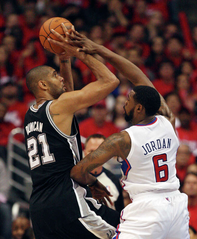 San Antonio Spurs' Tim Duncan (21) takes a shot against Los Angeles Clippers' DeAndre Jordan (06) in the third quarter of game four of the Western Conference semifinals at Staples Center in Los Angeles, Sunday, May 20, 2012.  Jerry Lara/San Antonio Express-News Photo: Jerry Lara, San Antonio Express-News / © San Antonio Express-News