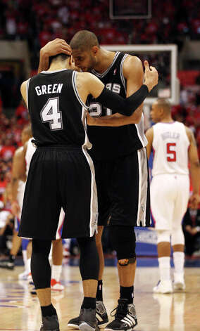 San Antonio Spurs' Tim Duncan talks with Danny Green late in the fourth quarter against the Los Angeles Clippers' in game four of the Western Conference semifinals at Staples Center in Los Angeles, Sunday, May 20, 2012.  The Spurs won, 102-99 and sweep the series to advance to the Western Conference Finals. Jerry Lara/San Antonio Express-News Photo: Jerry Lara, San Antonio Express-News / © San Antonio Express-News