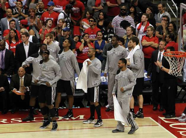 The Spurs bench celebrates at the closing moments of game 4 against the Los Angeles Clippers at the Western Conference semifinals at the Staples Center in Los Angeles on Sunday, May 20, 2012. The Spurs defeated the Clippers 102-99. Kin Man Hui/Express-News Photo: Kin Man Hui, SAN ANTONIO EXPRESS-NEWS / San Antonio Express-News