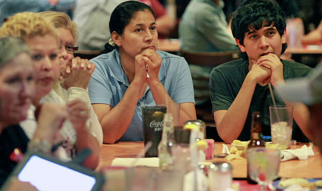 Lisa Salazar and son Jeremy Salazar watch national election returns at the election night watch party for State Representative Pete Gallego, D-Alpine, who is challenging U.S. Representative Francisco Canseco for his seat in the U.S. House District 23  on November 6, 2012. Photo: Tom Reel, San Antonio Express-News / ©2012 San Antono Express-News