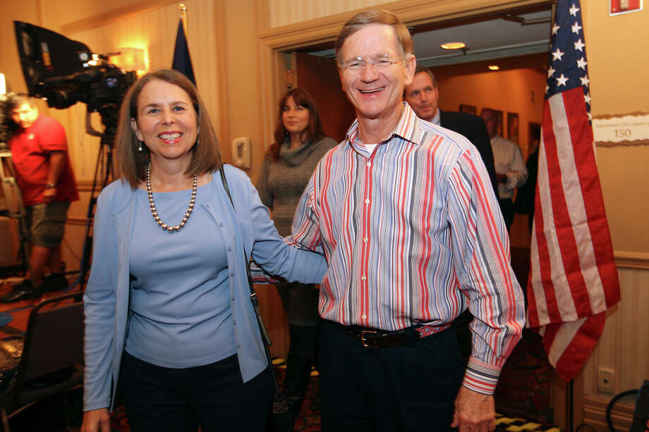 U.S. Rep. Lamar Smith and his wife, Beth, arrives at the Holiday Inn Airport on Election Night, Tuesday, Nov. 6, 2012. Smith has a commanding lead in the U.S. Rep. Dist. 21 race against Democratic candidate Candace Duval. Photo: Jerry Lara, San Antonio Express-News / © 2012 San Antonio Express-News