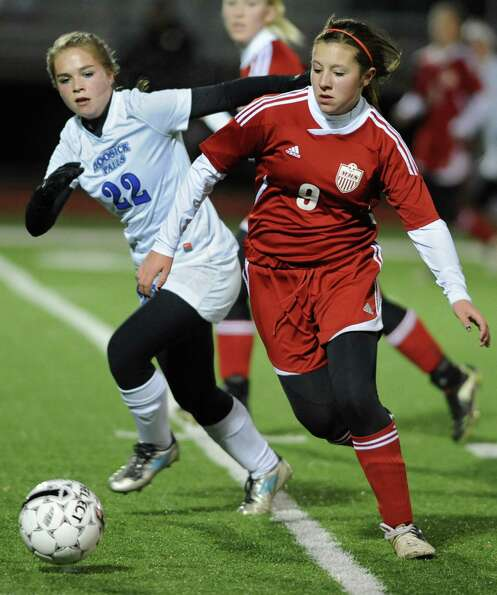 From left, Hoosick Falls' Jordyn Haynes battles for the ball with  Mechanicville's Devon Scott durin