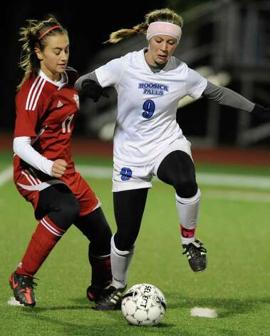 From left,  Mechanicville's Renate Gerstenberger battles for the ball with Hoosick Falls' Grace Delurey during the Class C Section II girls' soccer finals on Tuesday, Nov. 6, 2012 in Stillwater, N.Y.  (Lori Van Buren / Times Union) Photo: Lori Van Buren