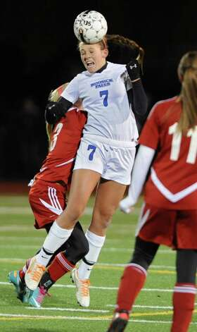 Hoosick Falls'  Mackenzie Hinchliffe heads the ball over Mechanicville's Samie Hayner during the Class C Section II girls' soccer finals on Tuesday, Nov. 6, 2012 in Stillwater, N.Y.  (Lori Van Buren / Times Union) Photo: Lori Van Buren