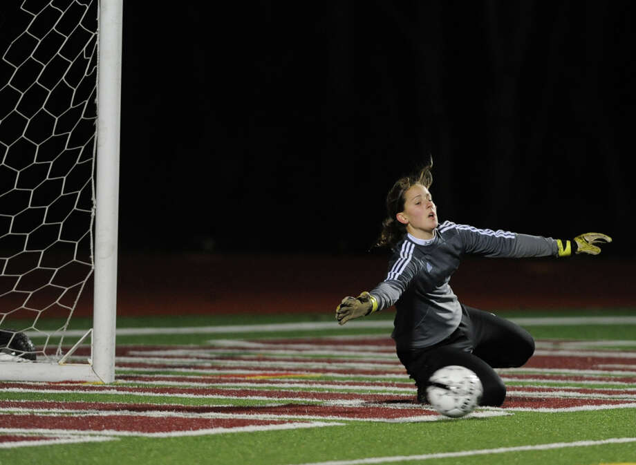 Mechanicville goal keeper Kim Thompson can't stop the ball that Hoosick Falls' Jordyn Haynes kicked from going into her net during the Class C Section II girls' soccer on Tuesday, Nov. 6, 2012 in Stillwater, N.Y.  (Lori Van Buren / Times Union) Photo: Lori Van Buren