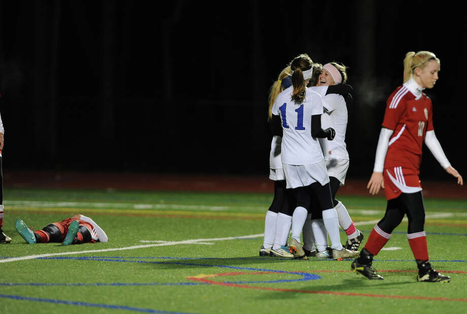Hoosick Falls players celebrate after Jordyn Haynes scores during the Class C Section II girls' soccer finals against Mechanicville on Tuesday, Nov. 6, 2012 in Stillwater, N.Y.  (Lori Van Buren / Times Union) Photo: Lori Van Buren