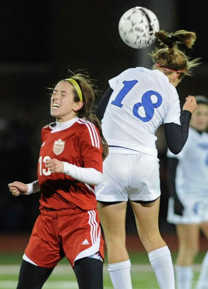 From left, Mechanicville's Mikayla Gowett battles for the ball with Hoosick Falls' Alyssa Houghton during the Class C Section II girls' soccer finals on Tuesday, Nov. 6, 2012 in Stillwater, N.Y.  (Lori Van Buren / Times Union) Photo: Lori Van Buren