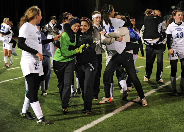 Hoosick Falls players celebrate after winning the Class C Section II girls' soccer final against Mechanicville on Tuesday, Nov. 6, 2012 in Stillwater, N.Y.  (Lori Van Buren / Times Union) Photo: Lori Van Buren