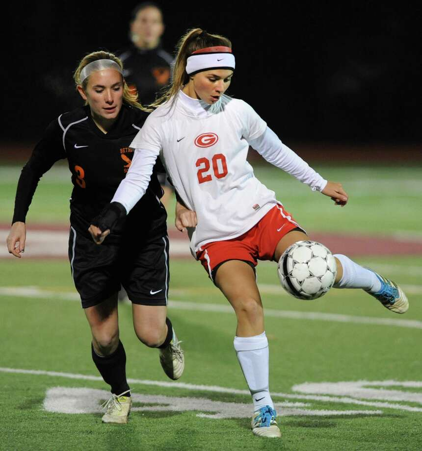 From left, Bethlehem's Elle Lutz battles for the ball with Guilderland's Angela Luizzi during the Class AA Section II girls' soccer finals on Tuesday, Nov. 6, 2012 in Stillwater, N.Y.  (Lori Van Buren / Times Union) Photo: Lori Van Buren