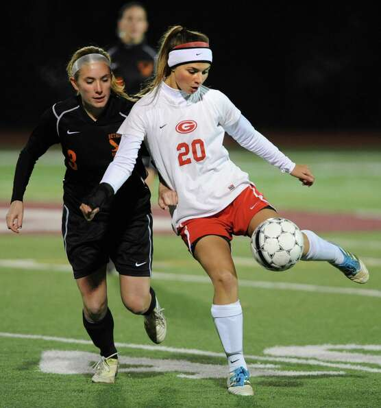 From left, Bethlehem's Elle Lutz battles for the ball with Guilderland's Angela Luizzi during the Cl