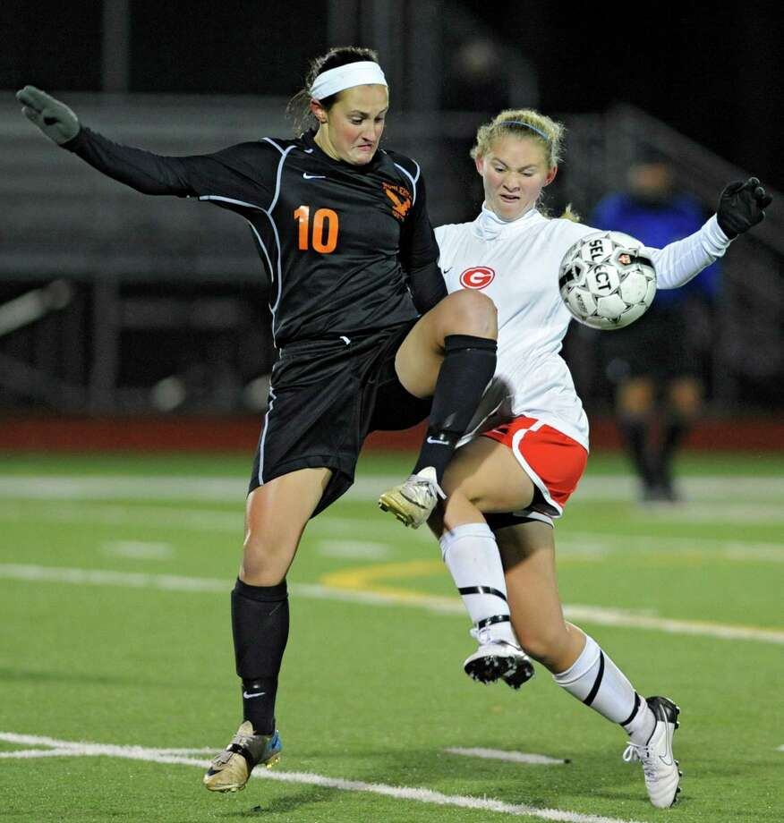 From left, Bethlehem's Kaylee Rickert battles for the ball with Guilderland's Brittney Pulliam during the Class AA Section II girls' soccer finals on Tuesday, Nov. 6, 2012 in Stillwater, N.Y.  (Lori Van Buren / Times Union) Photo: Lori Van Buren