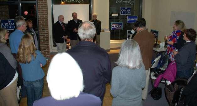 Supporters listen as state Rep. Jonathan Steinberg --- flanked by First Selectman Gordon Joseloff, left, and challenger Stephen Rubin --- talks to them about his victory in the 136th House District. Photo: Contributed Photo, Jarret Liotta/Contributed Photo / Westport News
