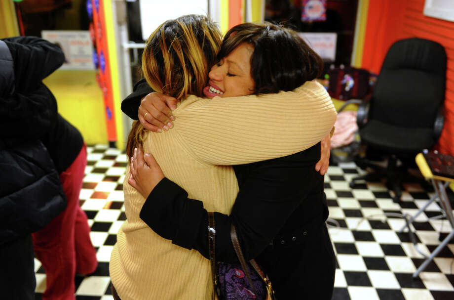 Campaign worker Aidee Nieves, left, hugs Christina Ayala who won a democratic seat in the 128th district, during Ayala's campaign HQ on East Main Street in Bridgeport, Conn. on Tuesday November 6, 2012. Photo: Christian Abraham / Connecticut Post