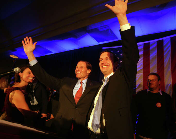 Chris Murphy, right, and Senator Richard Blumenthal wave to the crowd following Murphy's victory spe