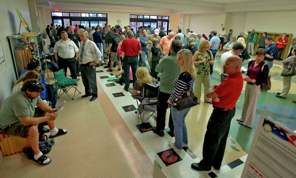 Voters line up to cast their ballots at the Southwest Regional Library, Tuesday, Nov. 6, 2012, in Pe