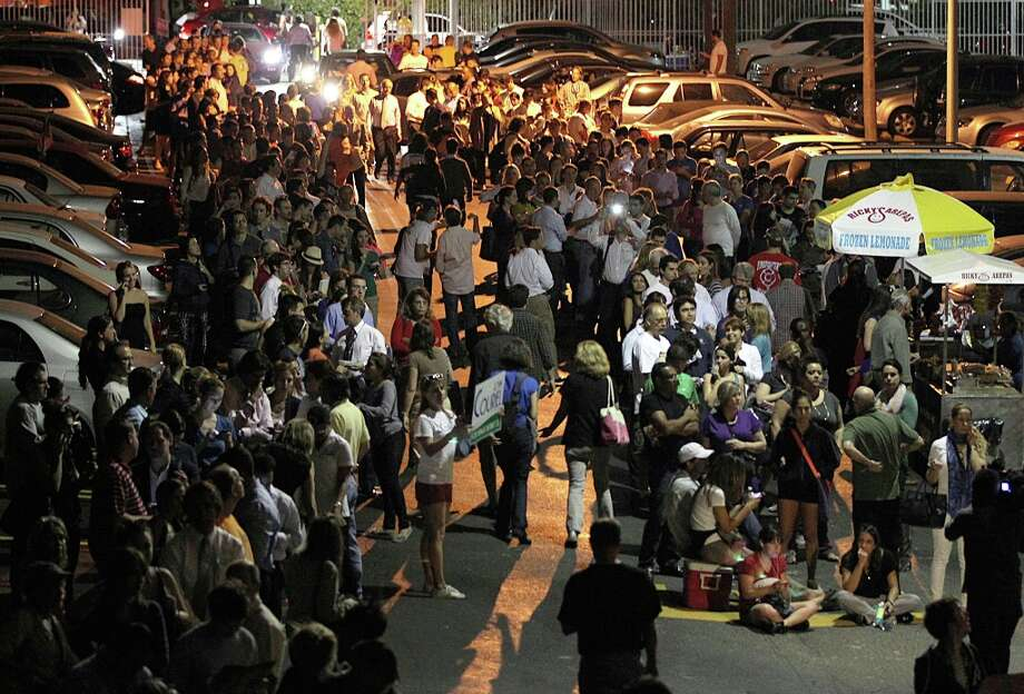 Hundred of voters wait in long lines to cast their ballots on Election Day, Tuesday, Nov. 6, 2012, in Miami. (AP Photo/El Nuevo Herald, Pedro Portal)  MAGS OUT Photo: Pedro Portal, Associated Press / El Nuevo Herlad