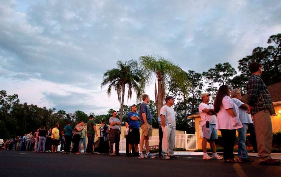 Voters stand in line at a Fort Myers, Fla. church late Tuesday, Nov. 6, 2012. After a grinding presi
