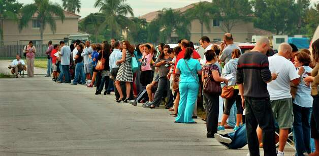 Voters wait in line tocast their ballots at a polling station, Tuesday, Nov. 6, 2012, in Miami. After a grinding presidential campaign President Barack Obama and Republican presidential candidate, former Massachusetts Gov. Mitt Romney, yield center stage to American voters Tuesday for an Election Day choice that will frame the contours of government and the nation for years to come. (AP Photo/The Miami Herald, Tim Chapman)  MAGS OUT Photo: Tim Chapman, Associated Press / Miami Herald