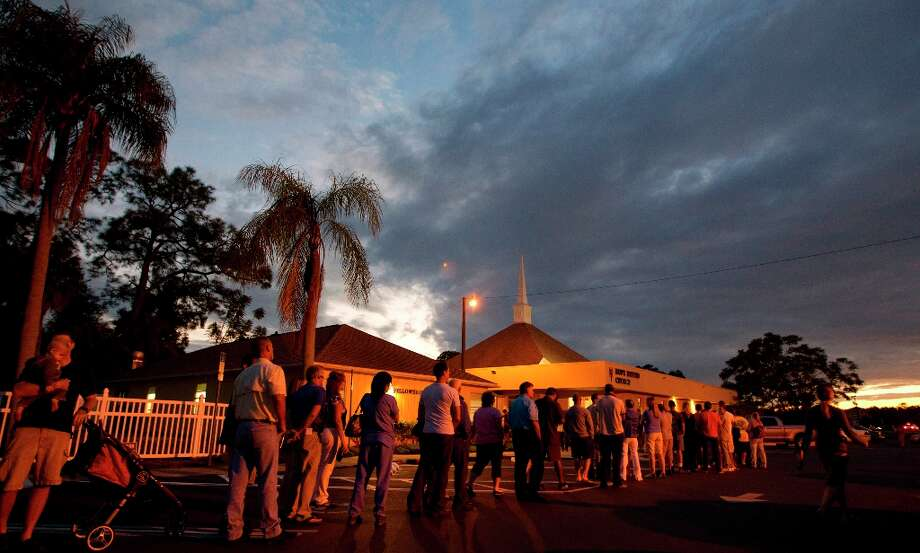 Voters stand in line at a Fort Myers, Fla. church late Tuesday, Nov. 6, 2012. After a grinding presidential campaign President Barack Obama and Republican presidential candidate, former Massachusetts Gov. Mitt Romney, yield center stage to American voters Tuesday for an Election Day choice that will frame the contours of government and the nation for years to come.  (AP Photo/J Pat Carter) Photo: J Pat Carter, Associated Press / AP