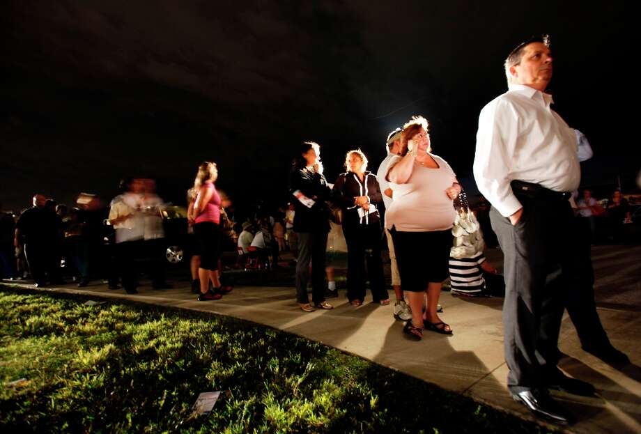 Voters line up in the dark  to cast their ballots at a polling station, Tuesday, Nov. 6, 2012 in Miami. After a grinding presidential campaign President Barack Obama and Republican presidential candidate, former Massachusetts Gov. Mitt Romney, yield center stage to American voters Tuesday for an Election Day choice that will frame the contours of government and the nation for years to come.  (AP Photo/Wilfredo Lee) Photo: Wilfredo Lee, Associated Press / AP