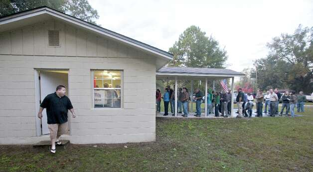 CRAWFORDVILLE, FL -  NOVEMBER 6:  A voter leaves after casting his ballot just after dawn as voters queue to place their ballots at the tiny County Polling House in the Ivan Community of Wakulla County on November 6, 2012 in Crawfordville, Florida. The swing state of Florida is recognised to be a hotly contested battleground that offers 29 electoral votes, as recent polls predict that the race between U.S. President Barack Obama and Republican presidential candidate Mitt Romney remains tight. (Photo by Mark Wallheiser/Getty Images) Photo: Mark Wallheiser, Getty Images / 2012 Getty Images