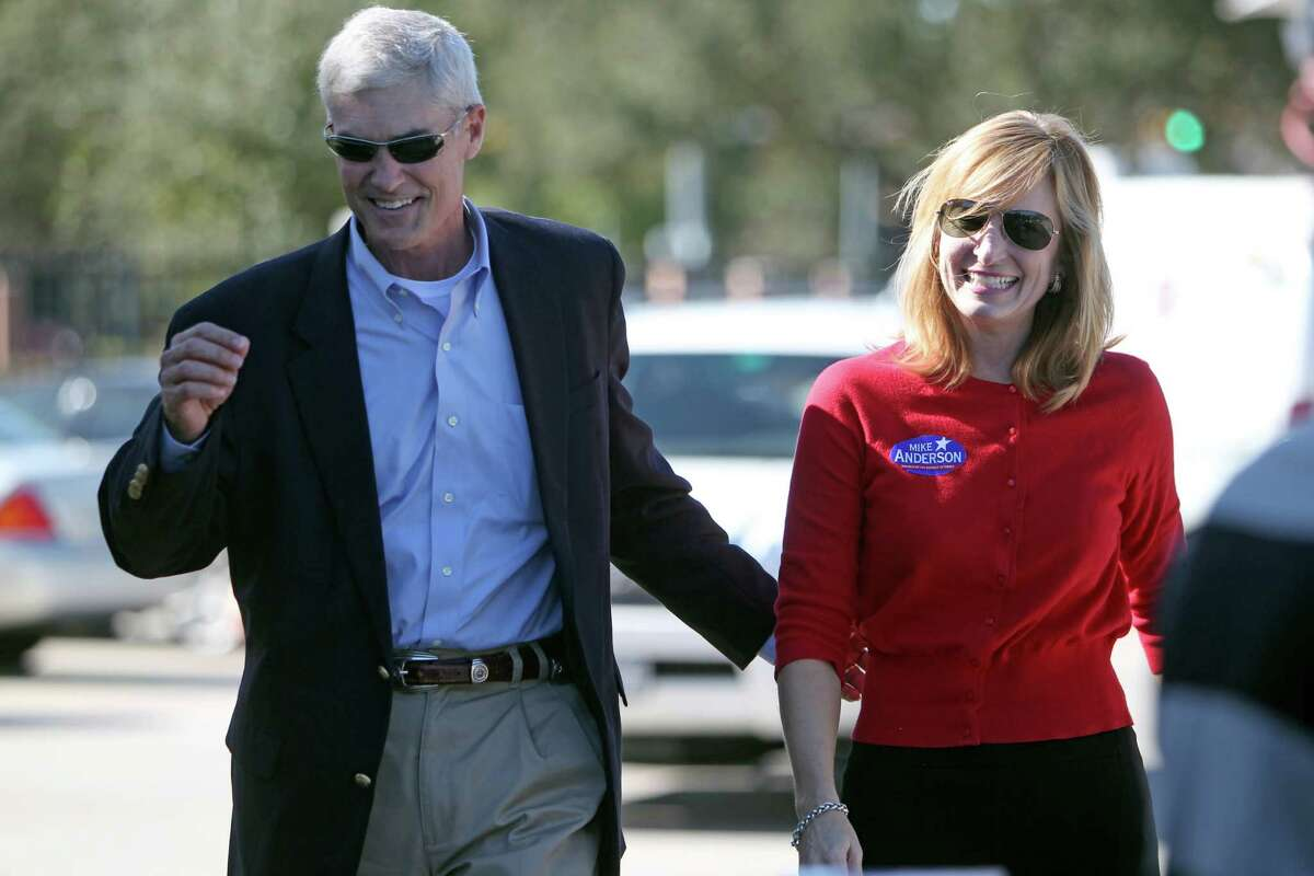 Mike Anderson and his wife, Devon Anderson, arrive at a polling location, Briargrove Elementary, on Tuesday. Hours later he was elected district attorney.