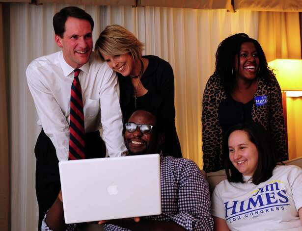 Congressman Jim Himes (D-4th), with wife Mary, watches poll numbers with staffers Tanya Myers, top right, Justin Myers and Susie Monsell in his hotel room Tuesday, Nov. 6, 2012 at the Holiday Inn in Bridgeport, Conn. Photo: Autumn Driscoll / Connecticut Post