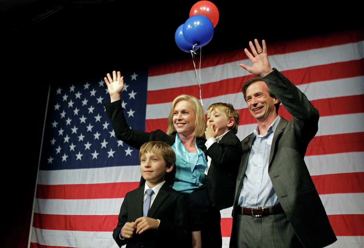 U.S. Sen. Kirsten Gillibrand D-N.Y., left, husband Jonathan, and sons Henry, 4, and Theodore, 8, celebrate on stage at New York State Democratic Headquarters after Gillbrand was predicted to win election for a full term as senator, Tuesday, Nov. 6, 2012, in New York. Gillbrand was pitted against Republican opponent Wendy Long.