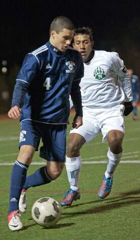Wilton high school's David Brown tries to get by Norwalk high school's Santiago Muriel in the FCIAC boy's soccer semifinal game held at Fairfield Ludlowe high school, Fairfield, CT on Tuesday November 6th, 2012. Photo: Mark Conrad / Stamford Advocate Freelance