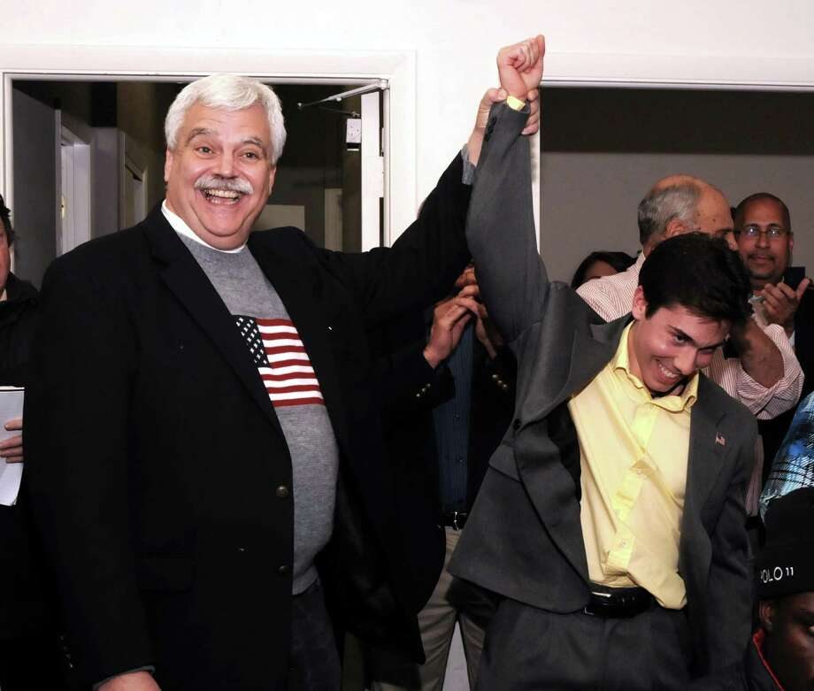 Bob Godfrey reacts with joy when it's announced that David Arconti, 26, won the 109th district State Representative seat on Tuesday Nov. 6, 2012 at Danbury's Democratic headquarters. Photo: Lisa Weir / The News-Times Freelance