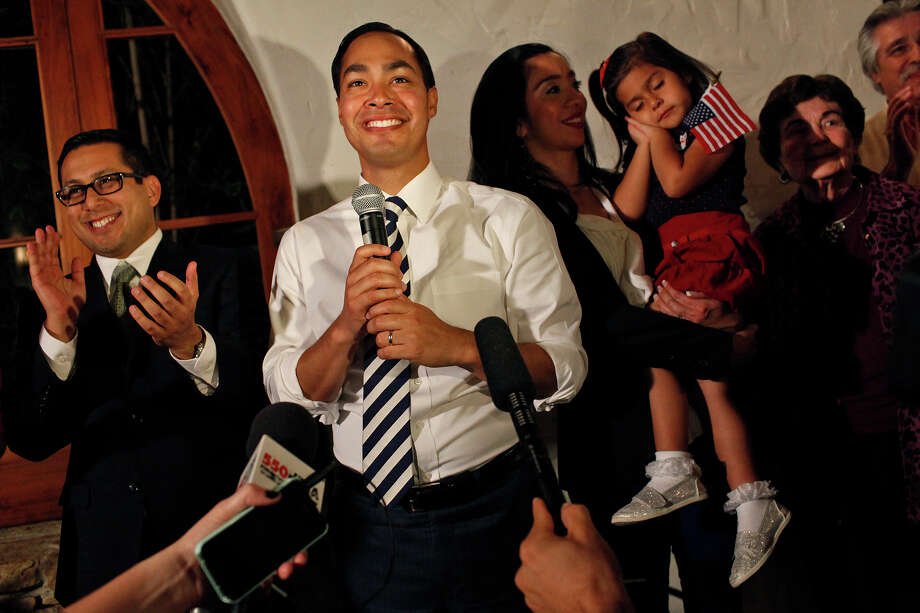 Mayor Julián Castro thanks his supporters and staff as results for the Pre-K 4 SA campaign come in during an election watch party. With him are City Councilman Diego Bernal and the mayor's wife, Erica Castro, who's holding daughter Carina. Photo: Lisa Krantz, San Antonio Express-News / © 2012 San Antonio Express-News